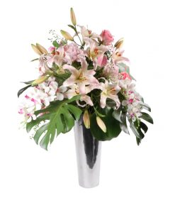 Casablanca Lilies, orchids and roses in silvel looc vase