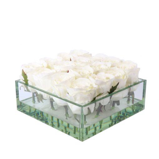 White roses in squate glass vase