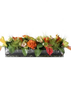 Tropical mix of anthurium,angel's trumpet, orquids, and protea in WaterLook glass vase