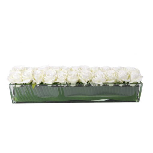 White roses in rectangular glass vase